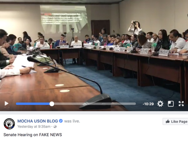 SEATED ACROSS. Who was handling and taking Facebook Live video on Mocha Uson Blog while its owner was seated across the broadcast gadget? Screenshot from Mocha Uson Blog