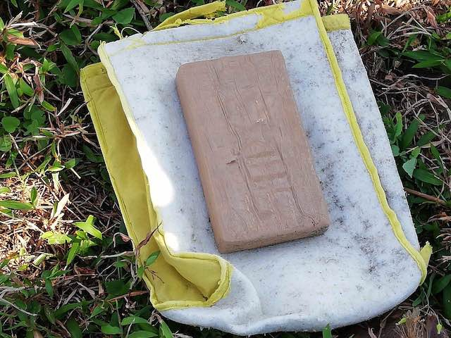 INTACT ON SHORE. The cocaine brick in Quezon is found by barangay watchman. PNP photo