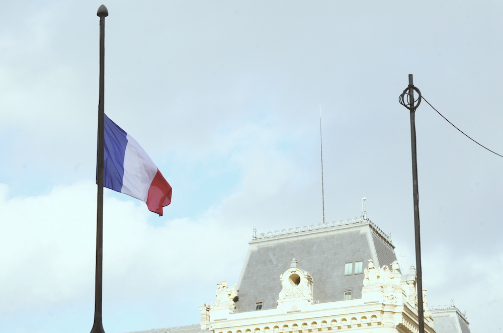 HALF MAST. A French flag flies at half mast to commemorate the November 13 attacks. Photo by Chad Versoza