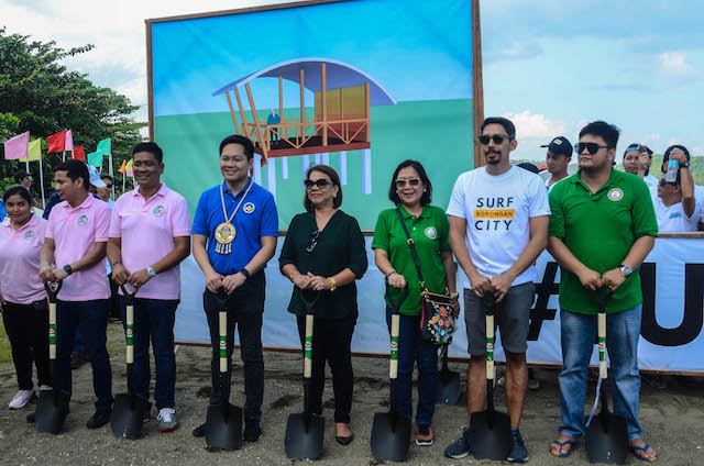 MAKING WAVES. Cabinet Secretary Karlo Nograles, Borongan City Mayor Dayan Agda, and Eastern Samar Representative Fe Abunda together with Surf Riders Club of Eastern Samar president Rupert Ambil lead the groundbreaking of the event's judging tower. Photo by Alren Beronio/Surf in the City