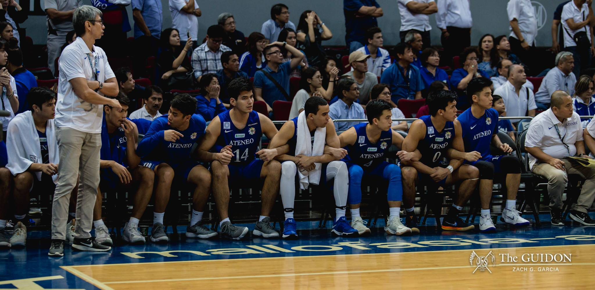 HEART-POUNDING. The Ateneo bench brace themselves for a cardiac game.  Photo by Zach Garcia/The GUIDON.
