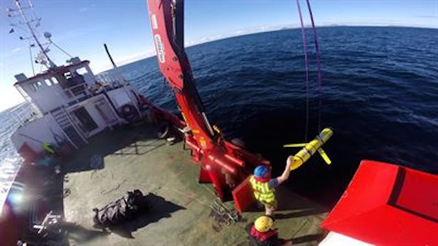 YELLOW DRONES. This photo shows the recovery of US ocean gliders off the coast of Scotland. A similar unmanned underwater vehicle was seized by the Chinese Navy off the coast of the Philippines. Photo from the Pentagon web site