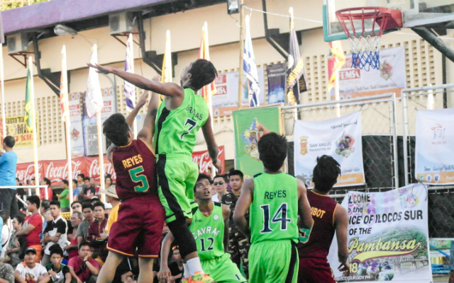 BLOCKED. Joshua Reyes of Davao Region (5) tries to shoot a floater against the defense of Carlo Bringas (7) of Cagayan Valley.