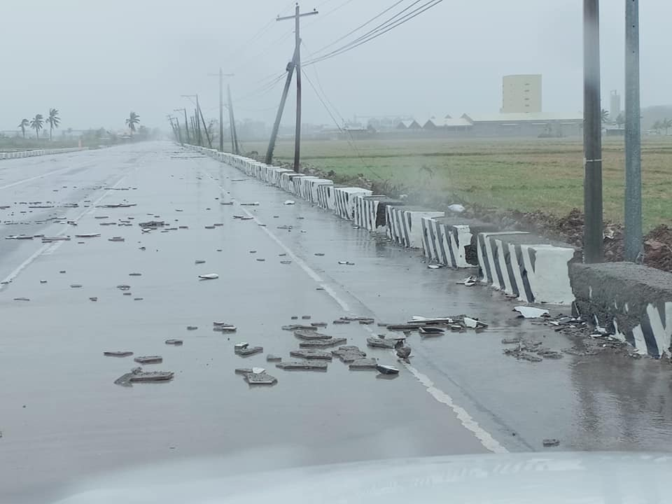 DEBRIS. Concrete fragments are scattered along a highway in the municipality of Alicia. Photo by MDRRMC Alicia