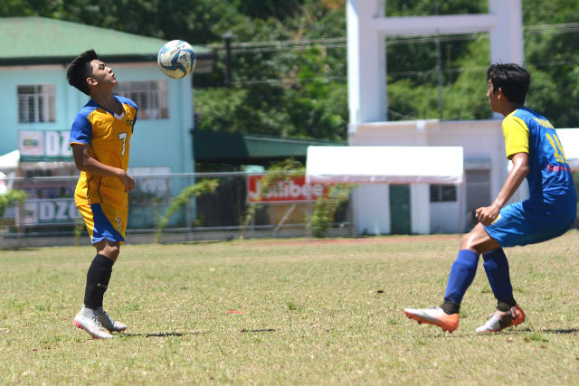 LEARNING FROM FOOTBALL. Chester Gio Pabualan (L) shares how he's learned discipline by playing football. Photo by Roy Secretario/Rappler