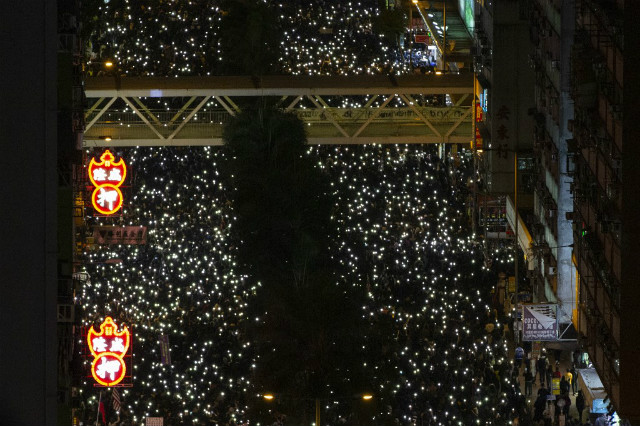 HUGE CROWDS. People raise their phone lights as they take part in a pro-democracy rally in Wan Chai in Hong Kong on December 8, 2019. Photo by Alastair Pike / AFP