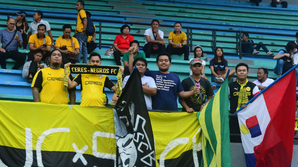SUPPORT. The Ceres Ultras, with Jan Eleven Gozon far left in yellow. Photo by Bob Guerrero/Rappler