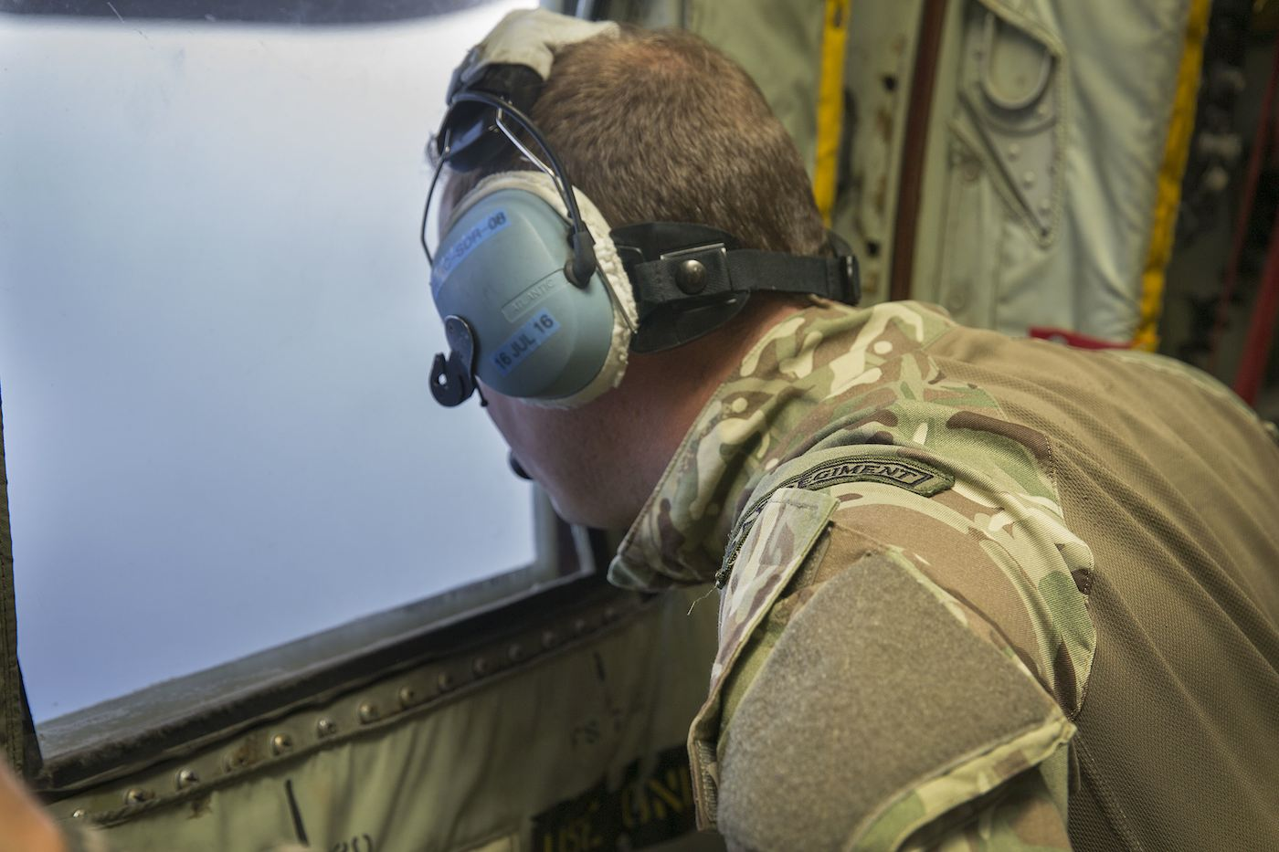 SEARCH. A handout picture shows a British Navy officer looking out the window of an Royal Air Force C-130 Hercules aircraft from RAF Akrotiri, Cyprus, assisting in the search and rescue operations for missing EgyptAir flight MS804 at sea in the Mediterranean off the Egyptian coast on 19 May 2016. Photo by Helen Rimmer / British Ministry of Defense / Crown Copyright / EPA
