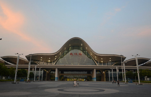 MAIN HUB. This photo taken in May 2014 shows passengers walking on the square outside Wuhan railway station in central China's Hubei province. File photo by AFP