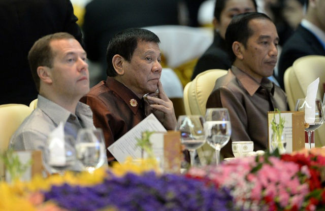 A DIFFERENT ARRANGEMENT. Philippine President Rodrigo Duterte (C) sits beside Russian Prime Minister Dmitry Medvedev (L) and Indonesia's President Joko Widodo at the gala dinner during the second day of the Association of Southeast Asian Nations (ASEAN) Summit in Vientiane on September 7, 2016. Photo by Noel Celis/ AFP