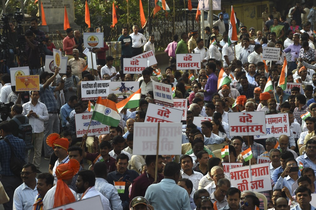'ANTI-MUSLIM' LAW? Protesters hold placards and Indian flags during a rally in support of India's new citizenship law in Mumbai on December 27, 2019. Photo by Indranil Mukherjee/AFP