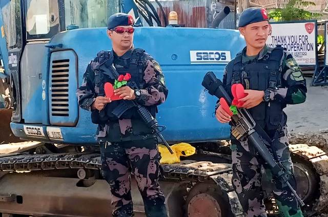 READY FOR INSPECTION. Policemen carry paper hearts and roses for their Valentine's Day inspection. PNP-ARMM Photo