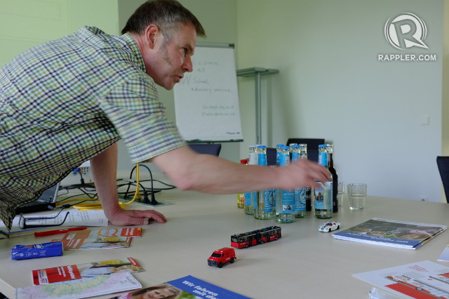 TEACHING COMMUTERS. Christoph Unland of the HVV School Advisory Service says teachers use simple props like car toys to teach students about safety when commuting