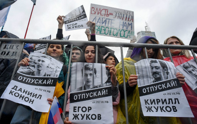 FREE. People hold a poster reading u0022Free (jailed student) Kirill Zhukov!u0022 as thousands of opposition supporters rallied in Moscow after mass police detentions at recent protests that have been among the largest since President's return to the Kremlin in 2012. Photo by Yuri Kadobnov/AFP