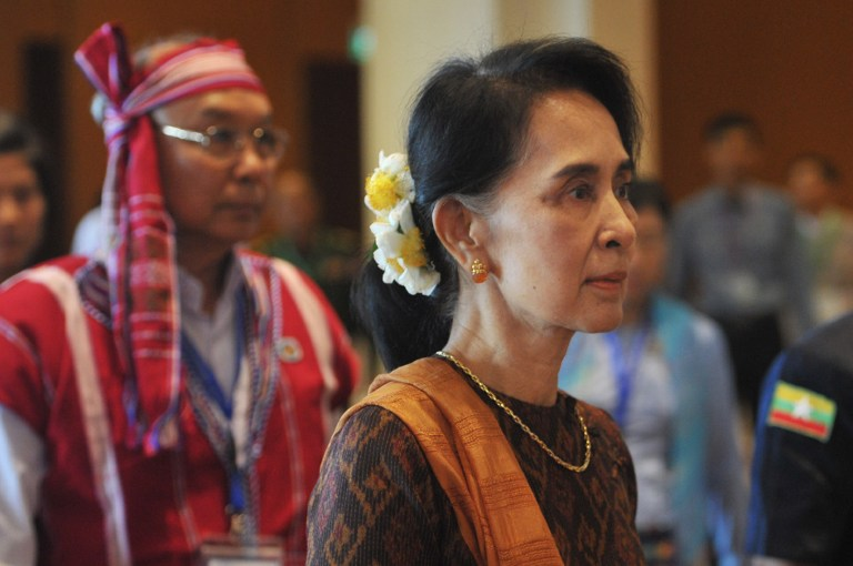 AUNG SAN SUU KYI. Myanmar State Counsellor Aung San Suu Kyi is accompanied by Parliament Speaker Mann Win Khaing Than (L) at the opening ceremony of the ASEAN Interparliamentary Assembly in Naypyidaw on September 30, 2016. File photo by Aung Htet/ AFP