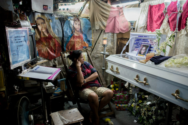 TOO SOON. Kimberly Sailog watches over the casket of her 12-year old daughter Kristine Joy in their shanty home on Christmas Eve, December 24, 2016. Photo by Eloisa Lopez