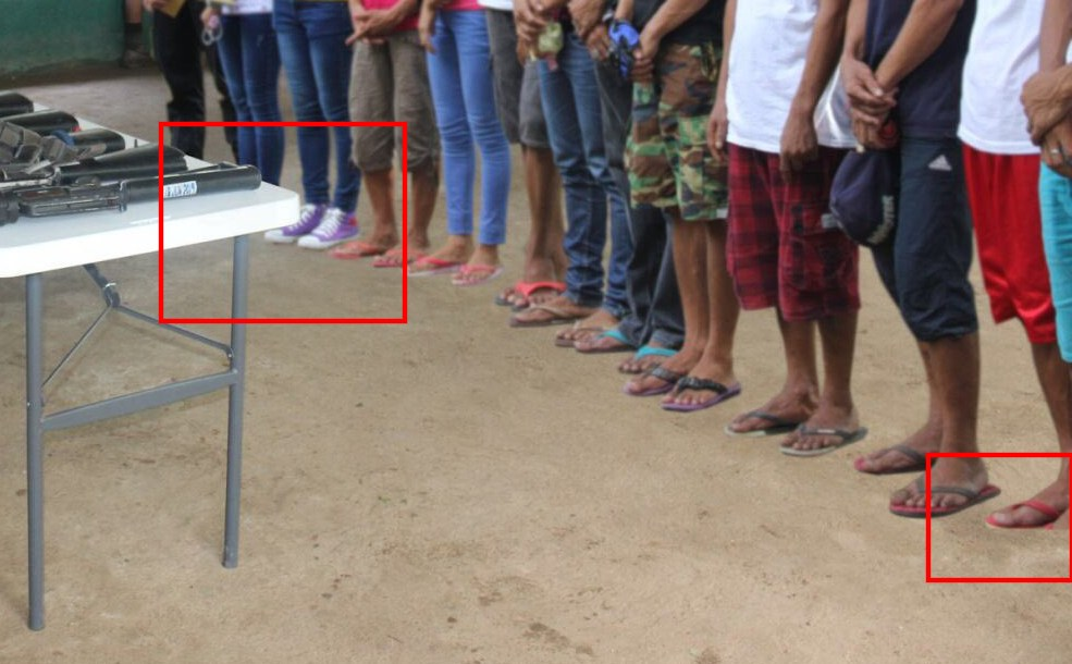 CROPPED? The red box on the right (emphasis ours) shows the cropped foot of the man. Photo from Philippine Army