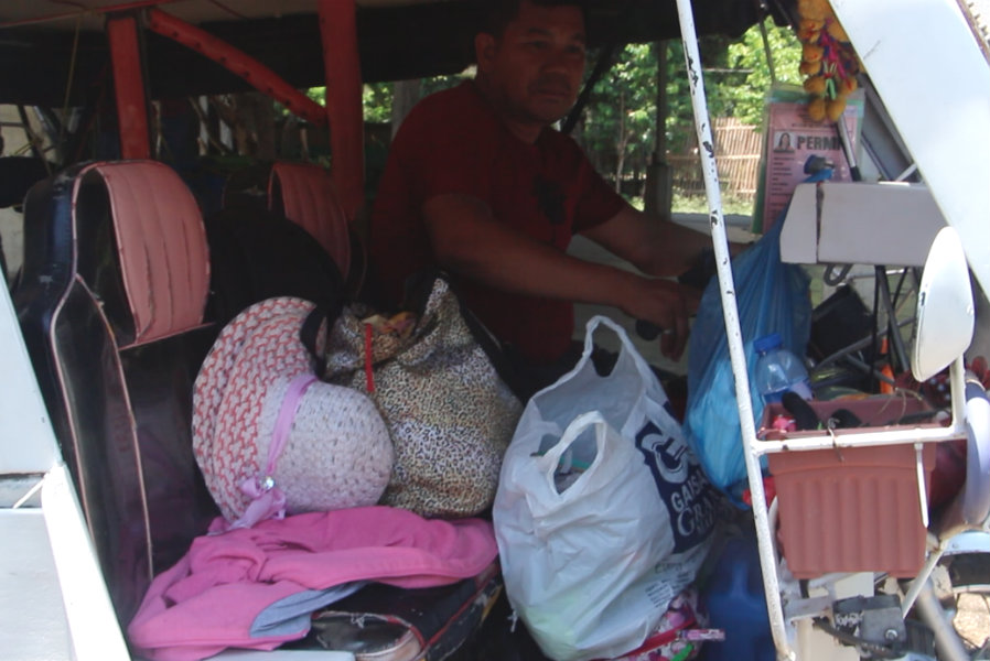 TRICYCLE. The Tapang family is scheduled to go back to Kidapawan via tricycle. Photo by Palaro Movers from Region XI