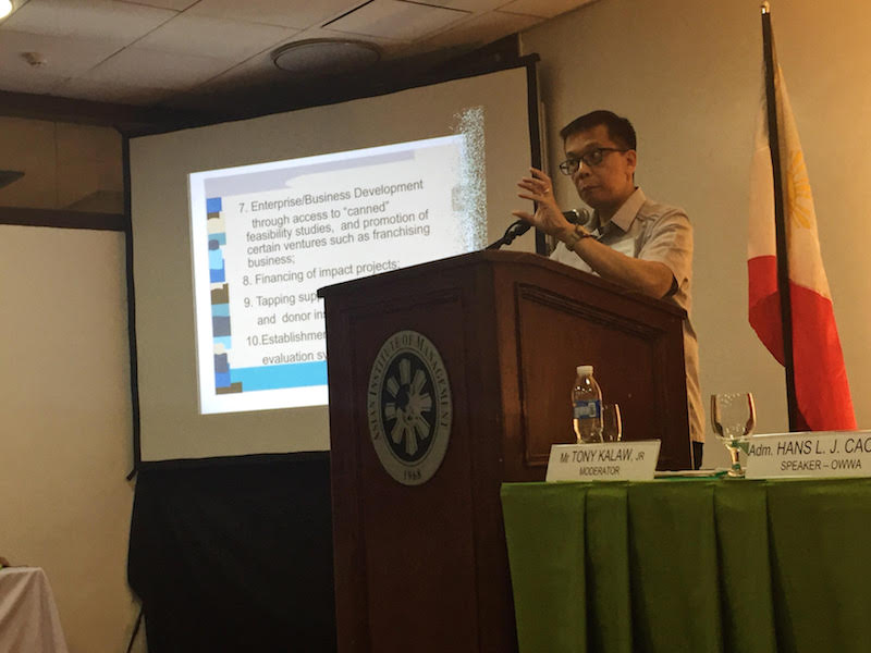 CHANGING NARRATIVE. OWWA Administrator Hans Leo Cacdac speaks at the Future of OFWs Conference on Friday, September 29. Photo by Don Kevin Hapal