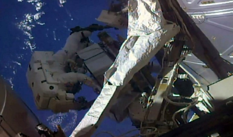 SPACE STATION. This NASA TV frame grab shows a pair of US astronauts as they began a spacewalk outside the International Space Station on May 16, 2018 to swap and check on two external cooling boxes, nicknamed 'Leaky' and 'Frosty.' File photo by NASA TV/AFP