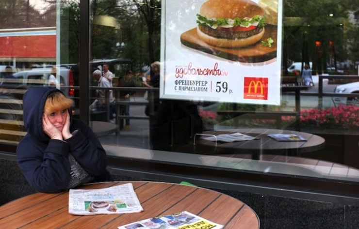 CLOSED. A woman sits a table of a closed McDonald's restaurant, the first to be opened in the Soviet Union in 1990, in Moscow on August 21, 2014. Photo by AFP/Alexander Nemenov