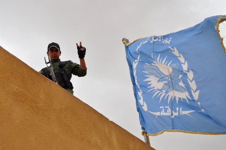 VICTORY. This file photo taken on May 23, 2017 shows a cadet from the Internal Security Forces of Raqa, the first police force formed by the US-led international coalition. Photo by Ayham al-Mohammad / AFP