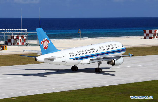 TEST FLIGHT. A civilian aircraft lands at the airfield on Fiery Cross Reef in the Spratly Islands, January 6, 2016. China successfully carried out test fights of two civilian aircraft on Wednesday on a newly-built airfield in the South China Sea. Photo by Cha Chunming/Xinhua
