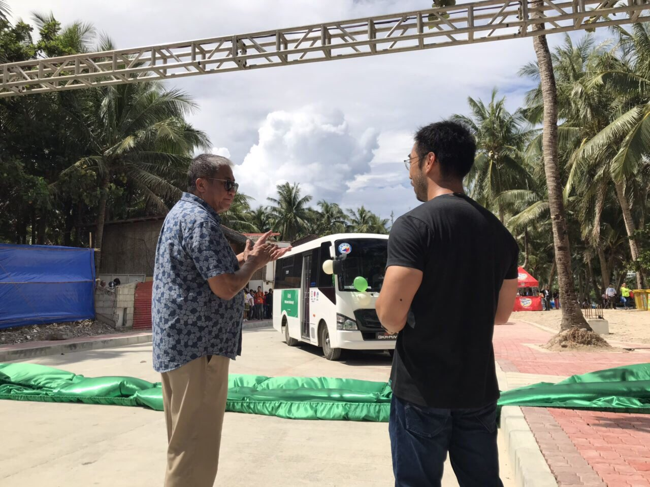 HOP-ON, HOP-OFF. Transportation Secretary Arthur Tugade and Grab Philippines head Brian Cu unveil the new hop-on, hop-off bus in Boracay.