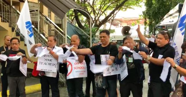 VIOLATION. Teachers tear copies of the PNP memorandum. Photo by Sofia Tomacruz/Rappler
