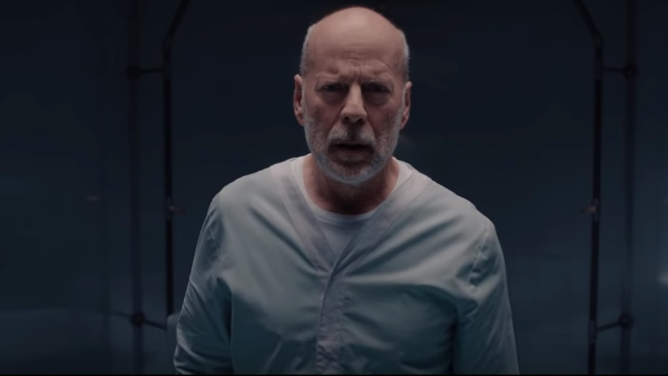 PSYCHOLOGICAL THRILLER. The third movie in director Shyamalan's Unbreakable and Split trilogy stars Bruce Willis as a superhuman locked in a psych ward. Screenshot from Universal Pictures' Youtube account