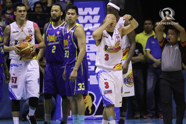 Rain or Shine guard Paul Lee holds on to his face after getting hit hard by Ivan Johnson. Photo by Josh Albelda/Rappler