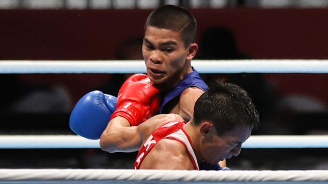 SPLIT DECISION. Carlo Paalam drops a close fight. Photo from Asian Games media pool