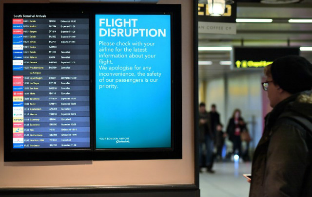 CHAOS. An information board displays flight information follwing disruption, in the South Terminal building at London Gatwick Airport, south of London, on December 21, 2018, as flights started to resume following the closing of the airfield due to a drones flying. Photo by Ben Stansall/AFP
