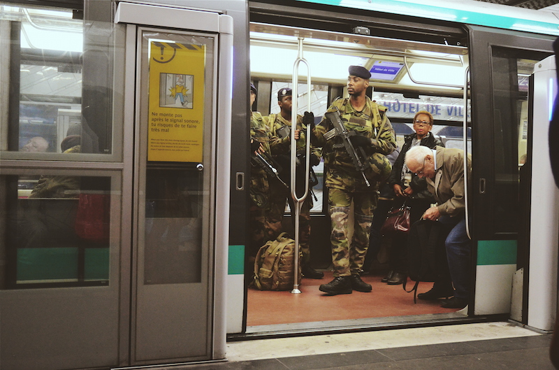 NEW NORMAL. Soldiers check trains as Paris remains on high alert. Photo by Chad Versoza