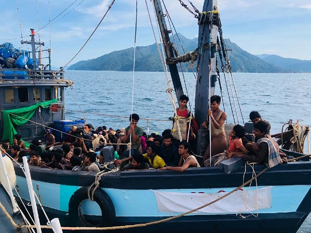 REFUGEE. This handout photo taken and released on April 5, 2020 shows a wooden boat carrying suspected Rohingya migrants detained in Malaysian territorial waters off the island of Langkawi. Handout photo by Malaysian Maritime Enforcement Agency/AFP