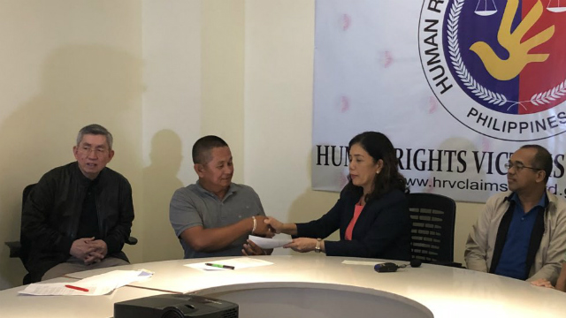 VICTIMS. HRVCB Chairperson Lina Sarmiento with board mebers Atty Wilfred Asis and Atty Galuasch Ballaho distribute checks to eligible claimants. Photo from Atty Ross Tugade of HRVCB