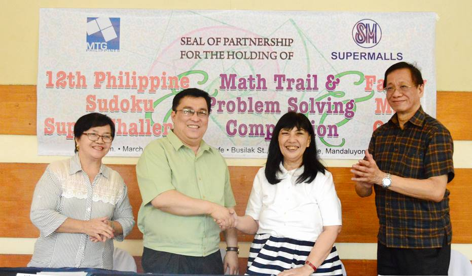 Millie Dizon (2nd from right), SM senior vice president for marketing and communications, and MTG president Dr. Isidro Aguilar (2nd from left) shake hands after signing an agreement to launch this year'u0080u0099s 12th Philippine Sudoku Super Challenge and Family Math Quest together with Dr. Simon Chua (extreme right) and Myrna Agtarap (extreme left). Photo by MTG