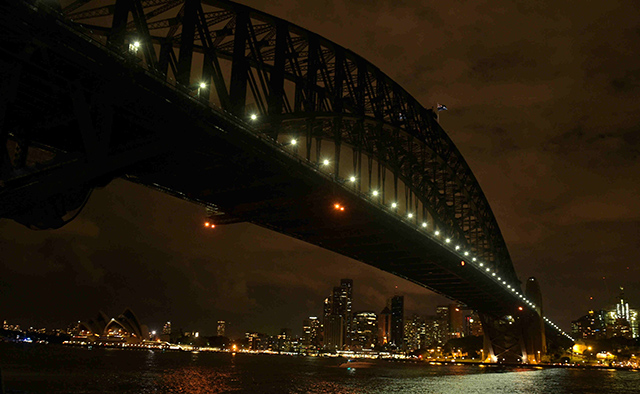 EARTH HOUR. In a long exposure image, the Sydney skyline during Earth Hour (below) in Sydney, from Milson's Point, Australia, 19 March 2016. Sam Mooy/EPA