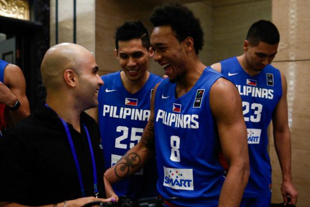 Calvin Abueva and Dondon Hontiveros have made a new friend. Photo by FIBA.com