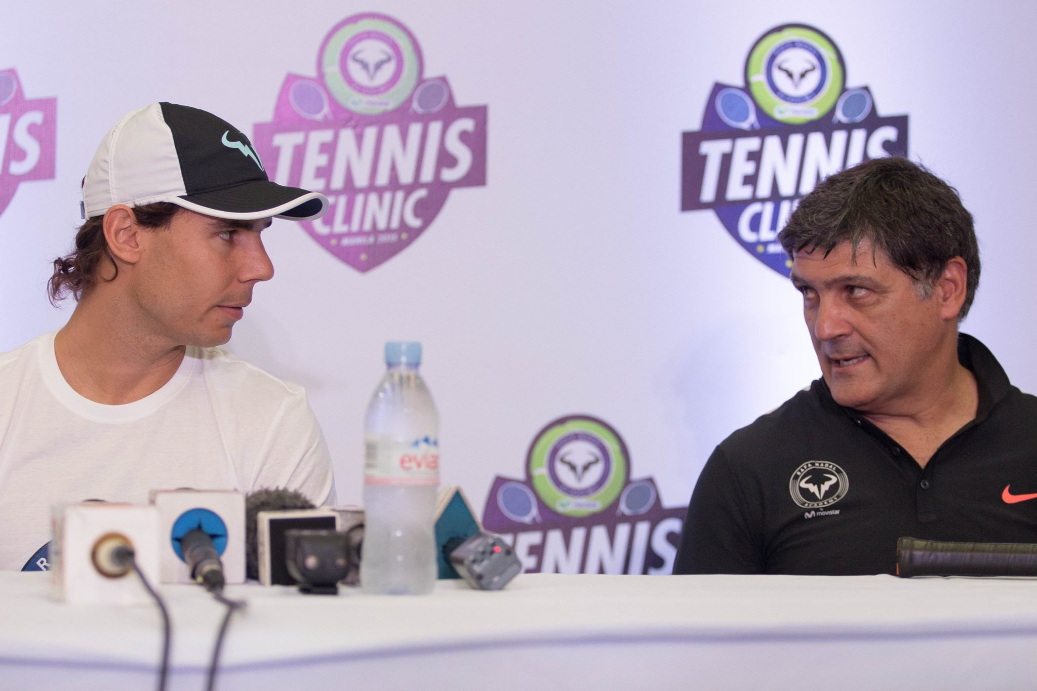 NADAL IN MANILA. Rafael Nadal and uncle/coach Toni Nadal look at each other during a media briefing. Photo by Ena Terol/Rappler