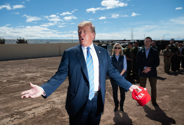 BORDER. US President Donald Trump tours the border wall between the United States and Mexico in Calexico, California, April 5, 2019. Photo by Saul Loeb/AFP