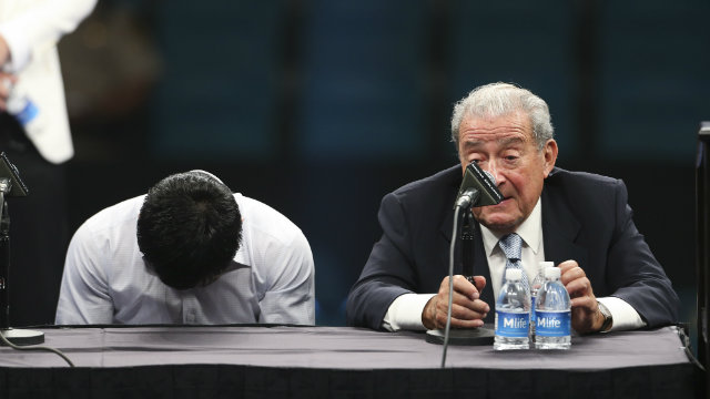 Manny Pacquiao hangs his head at the post-fight press conference. Photo by EPA