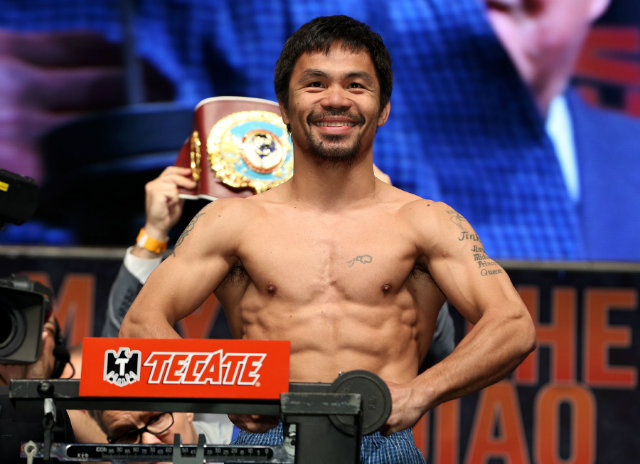Manny Pacquiao smiles as he weighs in. Photo by Chris Farina - Top Rank