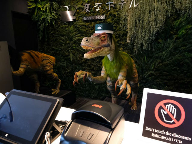 FUN. A robot dinosaur wearing a bellboy hats welcomes guests from the front desk at the Henn-na Hotel in Urayasu, suburban Tokyo on August 31, 2018. Photo by Kazuhiro Nogi/AFP