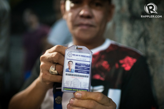 TOO SOON. Saldy delos Santos holds up his son's school ID, their only proper photo of Kian. Photo by Eloisa Lopez/Rappler