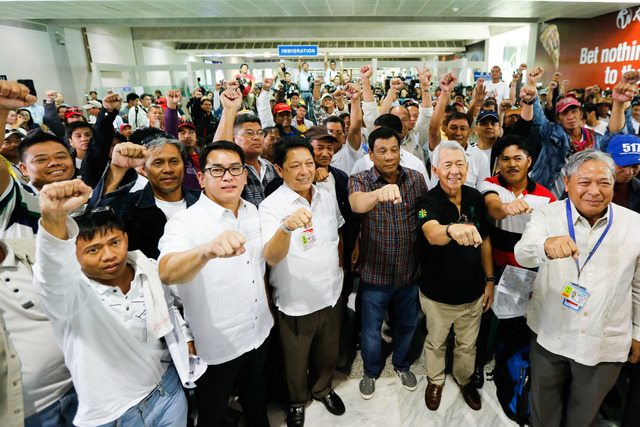 'WELCOME HOME.' President Rodrigo Duterte welcomes home 128 OFWs from Saudi Arabia who were fired from their jobs in an oil and gas company. Photo by Toto Lozano/PPD