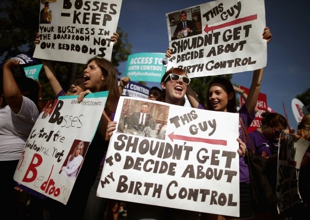 PROTEST. Supporters of employer-paid birth control rally in front of the Supreme Court before the decision in Burwell v. Hobby Lobby Stores was announced June 30, 2014 in Washington, DC. Photo by Chip Somodevilla /Getty Images /AFP