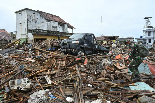 CHAOS. A soldier walks amid debris in the Sumber Jaya village in Sumur, Pandeglang, Banten province on December 25, 2018, 3 days after a tsunami hit the west coast of Indonesia's Java island. Photo by Adek Berry/AFP