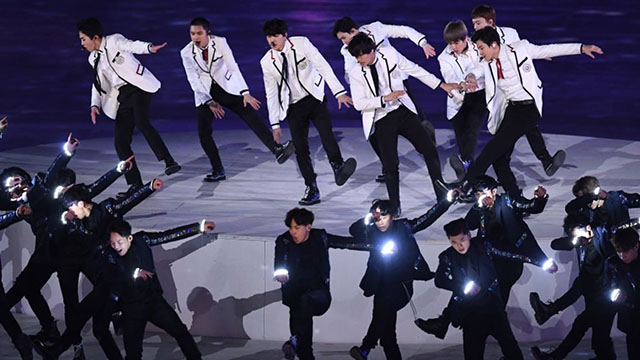CLASSIC WHITE. EXO dances their hit single 'Growl' at the 2018 Winter Olympics. Screenshot from YouTube.com/watch?v=UKCKn5RhbAw