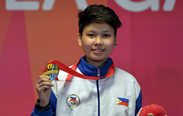 Chezka Centeno topped her compatriot Rubilen Amit to win gold in the women's 9-ball final. Singapore SEA Games Organising Committee/Action Images via Reuters